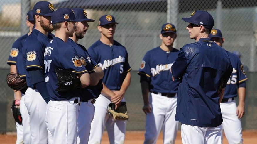 Feb 16, 2017; Maryvale, AZ, USA; Milwaukee Brewers manager Craig Counsell (30) talks to pitchers during spring training camp at Maryvale Baseball Park. Mandatory Credit: Rick Scuteri-USA TODAY Sports