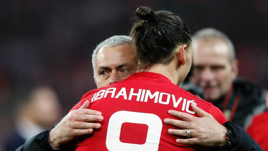 United manager Jose Mourinho, left, hugs United's Zlatan Ibrahimovic after they won the English League Cup final soccer match between Manchester United and Southampton FC at Wembley stadium in London, Sunday, Feb. 26, 2017. (AP Photo/Kirsty Wigglesworth)