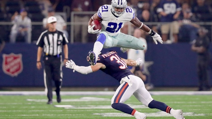 ARLINGTON, TX - SEPTEMBER 25: Ezekiel Elliott #21 of the Dallas Cowboys hurdles Chris Prosinski #31 of the Chicago Bears while carrying the ball in the fourth quarter at AT&T Stadium on September 25, 2016 in Arlington, Texas. (Photo by Tom Pennington/Getty Images)