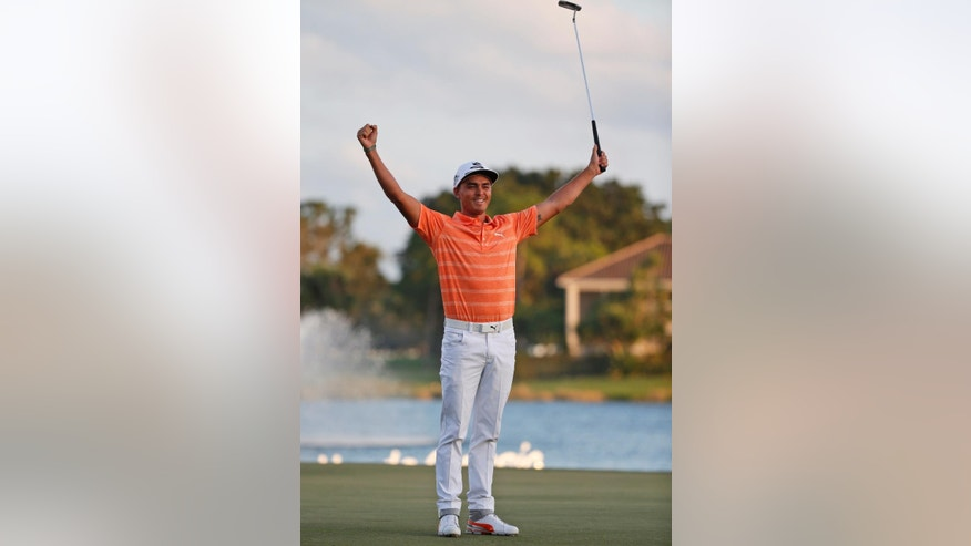 Rickie Fowler celebrates after winning the Honda Classic golf tournament, Sunday, Feb. 26, 2017, in Palm Beach Gardens, Fla. (AP Photo/Wilfredo Lee)
