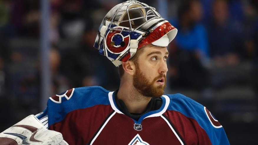 Colorado Avalanche goalie Jeremy Smith waits for the second period of the team's NHL hockey game against the Buffalo Sabres, Saturday, Feb. 25, 2017, in Denver. (AP Photo/David Zalubowski)