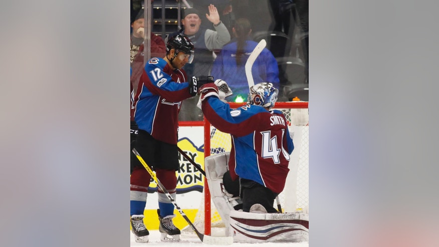 Colorado Avalanche right winger Jarome Iginla, left, congratulates goalie Jeremy Smith after he stopped the final shot from the Buffalo Sabres in the closing moments of an NHL hockey game Saturday, Feb. 25, 2017, in Denver. The Avalanche won 5-3. (AP Photo/David Zalubowski)