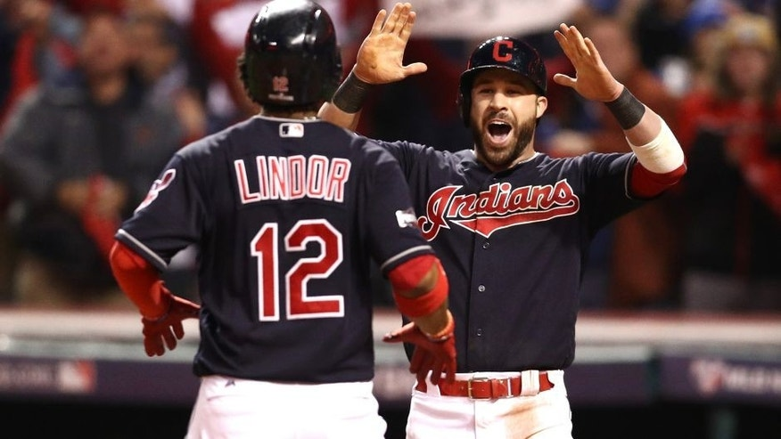 CLEVELAND, OH - OCTOBER 14: Francisco Lindor #12 of the Cleveland Indians celebrates with teammate Jason Kipnis #22 after hitting a two run home run to right field against Marco Estrada #25 of the Toronto Blue Jays in the sixth inning during game one of the American League Championship Series at Progressive Field on October 14, 2016 in Cleveland, Ohio. (Photo by Maddie Meyer/Getty Images)
