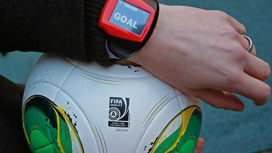 "FILE - The Dec. 8, 2012 file photo shows a referee's watch with the goal as they demonstrate the goal-line technology of Hawk-Eye system at Toyota stadium in Toyota. After PSV Eindhoven goalkeeper Jeroen Zoet made the save, he made a costly mistake on Sunday Feb. 26, 2017. Zoet saved a close-range header from Feyenoord defender Jan-Arie van der Heijden, but as he clutched the ball to his chest, a screen on referee Bas Nijhuis' wrist lit up. Nijhuis looked down, saw the word ""goal"" flashing on the screen and awarded the Dutch league leaders the winning score in a 2-1 victory. (AP Photo/Shuji Kajiyama/File)"