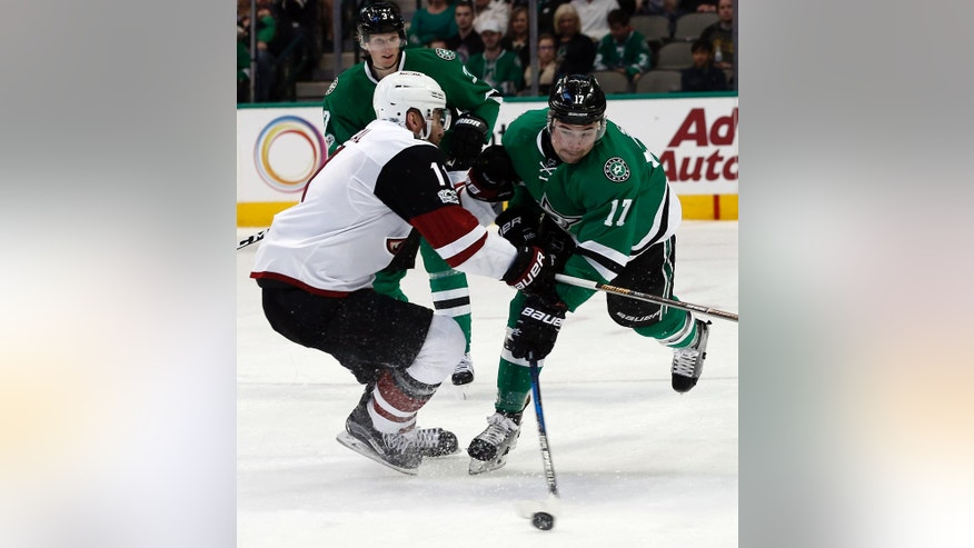FILE - In this Feb. 24, 2017, file photo, Arizona Coyotes' Martin Hanzal (11) checks Dallas Stars' Devin Shore (17) during the second period of an NHL hockey game in Dallas. No one outside Minnesota is cheering harder for the Wild than the Arizona Coyotes because they get a second-round pick if Martin Hanzal helps them reach the third round, and the Tampa Bay Lightning would love nothing more than Ben Bishop leading the Los Angeles Kings to the Stanley Cup Final. Conditional trades based on a team's playoff success, and a player's part in it, are all the rage right now. (AP Photo/Mike Stone, File)