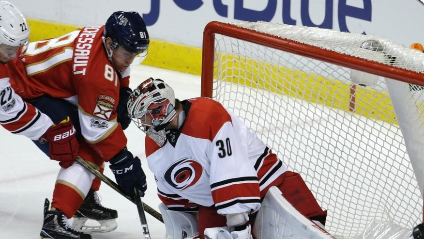 Carolina Hurricanes goalie Cam Ward (30) stops a shot by Florida Panthers' Jonathan Marchessault (81) during the second period of an NHL hockey game, Tuesday, Feb. 28, 2017, in Sunrise, Fla. (AP Photo/Lynne Sladky)
