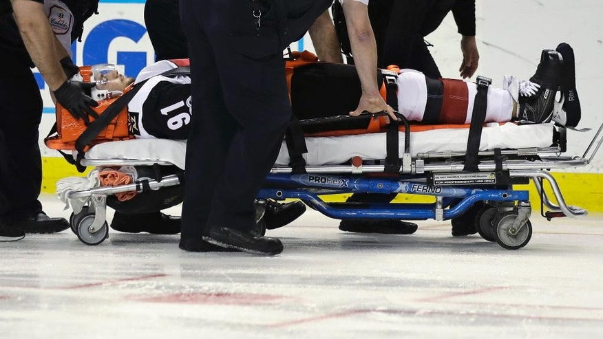 Arizona Coyotes center Alexander Burmistrov (91) is taken off the ice on a stretcher following a hit by Boston Bruins defenseman Colin Miller during the second period of an NHL hockey game in Boston, Tuesday, Feb. 28, 2017. (AP Photo/Charles Krupa)