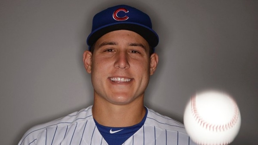 Chicago Cubs' Anthony Rizzo juggles during the team's photo day Tuesday, Feb. 21, 2017, in Mesa, Ariz. (AP Photo/Morry Gash)