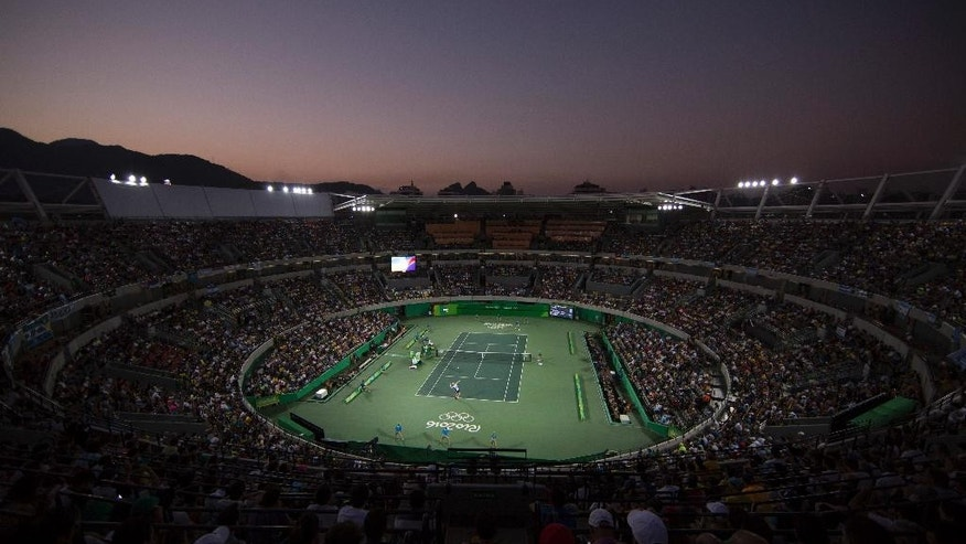 FILE - In this Aug. 14, 2016 file photo, Andy Murray, of England, and Juan Martin del Potro, of Argentina, compete at dusk in their gold medal match at the 2016 Summer Olympics in Rio de Janeiro, Brazil. The $50 million venue in suburban Barra da Tijuca is vacant, being run by Brazil's federal government, and needs events. (AP Photo/Felipe Dana, File)