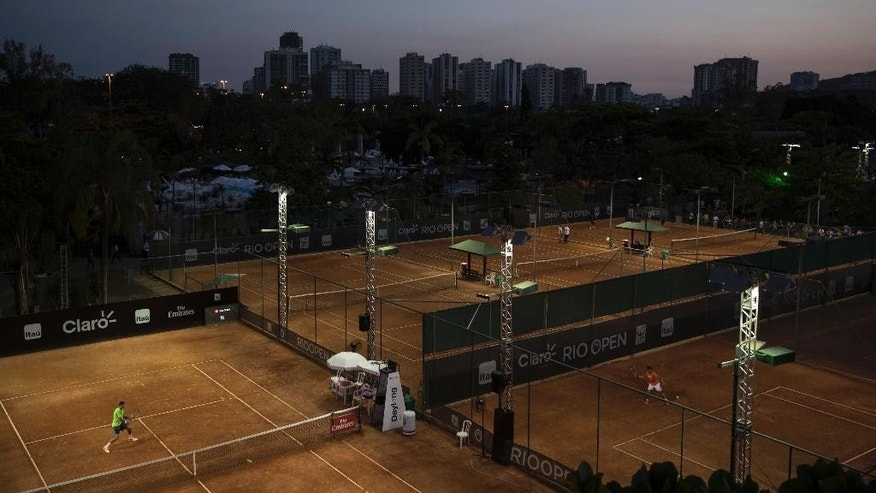 In this Feb. 23, 2017 photo, tennis players practice at the Rio Open tennis tournament in Rio de Janeiro, Brazil. The days of clay-court tennis in Latin America are numbered. The clay-court circuit lost a major event several years ago when this week's Mexican Open in Acapulco switched to hard courts. The Rio Open, which ended on Sunday, is almost certain to be next. And it could pull along several smaller clay-court tournaments in Quito, Buenos Aires and Sao Paulo. (AP Photo/Felipe Dana)