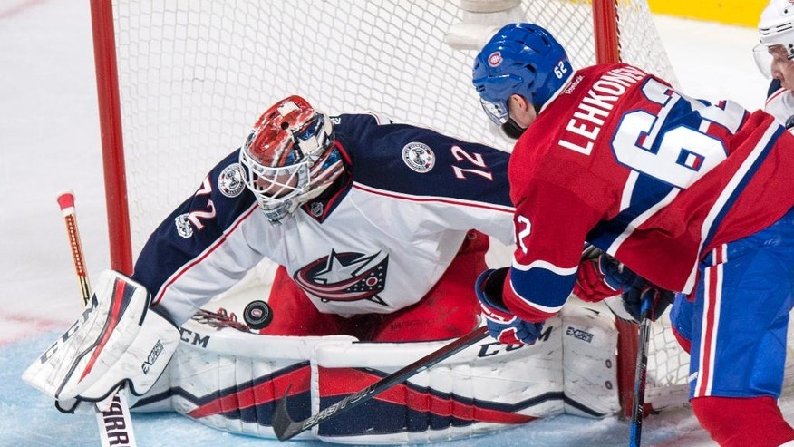Columbus Blue Jackets goalie Sergei Bobrovsky makes a save on Montreal Canadiens' Artturi Lehkonen during the second period of an NHL hockey game, Tuesday, Feb. 28, 2017 in Montreal. (Paul Chiasson/The Canadian Press via AP)