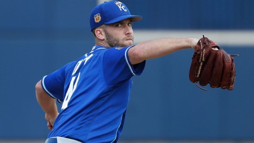 Kansas City Royals' Danny Duffy throws before the first inning of a spring training baseball game against the Milwaukee Brewers Tuesday, Feb. 28, 2017, in Phoenix. (AP Photo/Morry Gash)