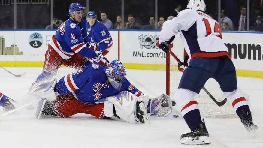 New York Rangers goalie Henrik Lundqvist (30), of Sweden, defends the goal as Washington Capitals' Justin Williams (14) attempts to score during the first period of an NHL hockey game, Tuesday, Feb. 28, 2017, in New York. (AP Photo/Frank Franklin II)