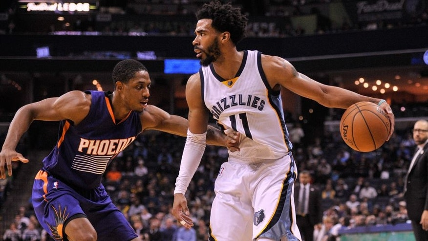 Feb 8, 2017; Memphis, TN, USA; Phoenix Suns guard Brandon Knight (11) guards Memphis Grizzlies guard Mike Conley (11) during the game at FedExForum. Memphis Grizzlies defeated the Phoenix Suns 110-91. Mandatory Credit: Justin Ford-USA TODAY Sports