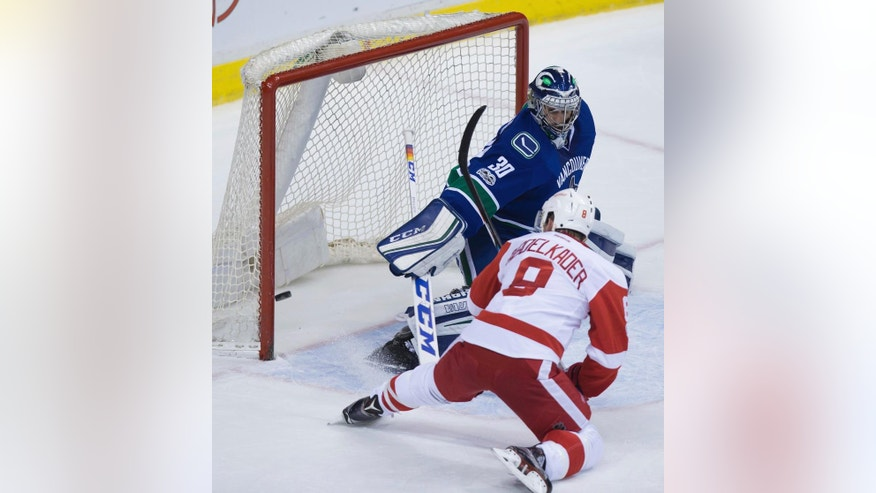 Detroit Red Wings' Justin Abdelkader (8) scores against Vancouver Canucks goalie Ryan Miller during overtime in an NHL hockey game Tuesday, Feb. 28, 2017, in Vancouver, British Columbia. (Darryl Dyck/The Canadian Press via AP)