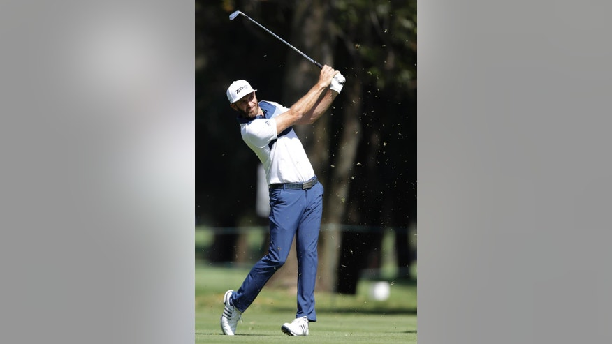 Dustin Johnson of the U.S. drives a ball on the eighth hole as golfers practice on the high-altitude course at Chapultepec Golf Club a day before the start of the Mexico Championship, in Mexico City, Wednesday, March 1, 2017. All but one of the world's top 50 golfers will contest the World Golf Championship PGA event, which this year relocated to Mexico City from the Trump National Doral Resort in Florida. (AP Photo/Rebecca Blackwell)