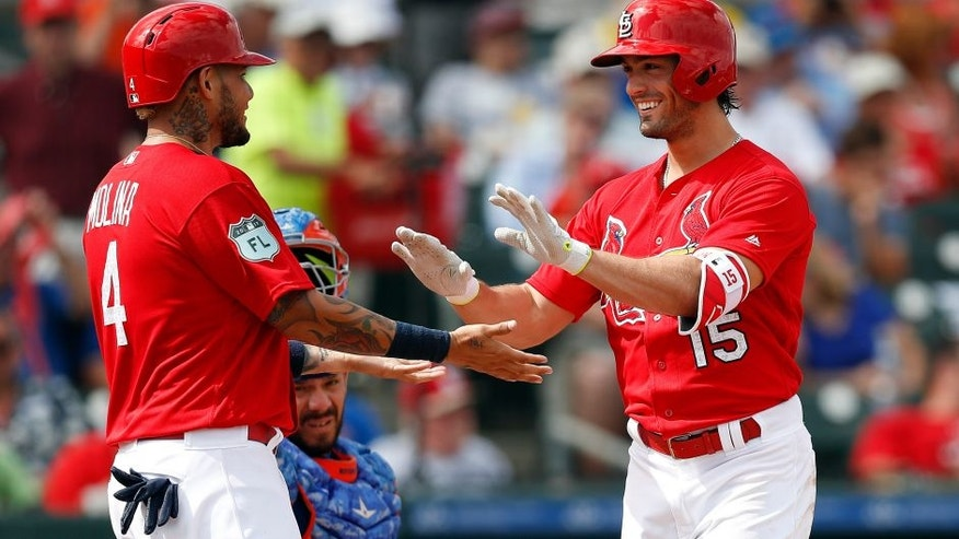 St. Louis Cardinals' Randal Grichuk (15) celebrates with Yadier Molina (4), left, after hitting a three-run home run in the third inning of a spring training baseball game against the New York Mets, Wednesday, March 1, 2017, in Jupiter, Fla. (AP Photo/John Bazemore)