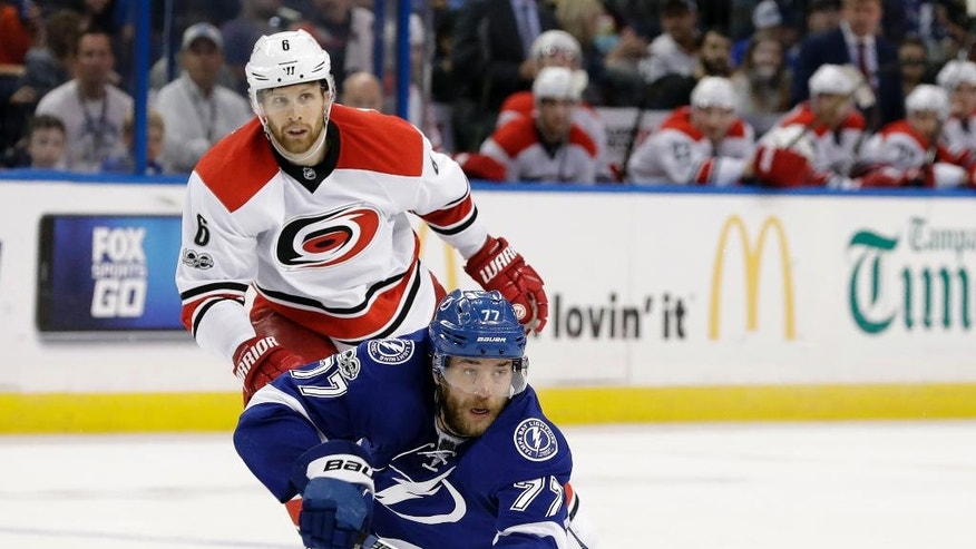 Tampa Bay Lightning defenseman Victor Hedman (77) passes the puck from his knees in front of Carolina Hurricanes defenseman Klas Dahlbeck (6) during the second period of an NHL hockey game Wednesday, March 1, 2017, in Tampa, Fla. (AP Photo/Chris O'Meara)