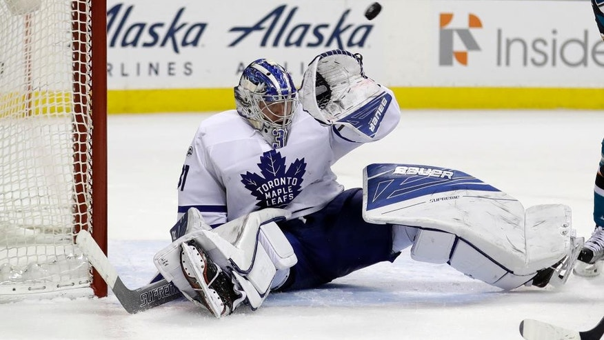 Toronto Maple Leafs goalie Frederik Andersen (31) deflects a San Jose Sharks shot during the second period of an NHL hockey game Tuesday, Feb. 28, 2017, in San Jose, Calif. (AP Photo/Marcio Jose Sanchez)