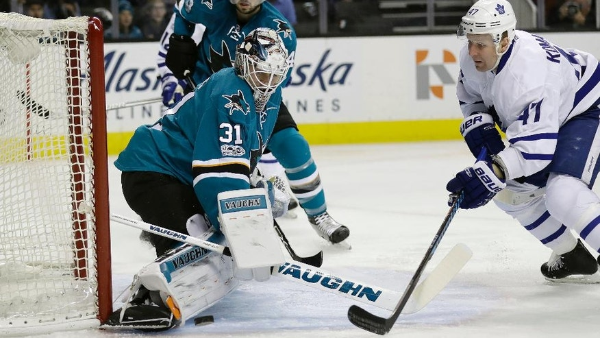 San Jose Sharks goalie Martin Jones, left, stops a shot from Toronto Maple Leafs' Leo Komarov (47) during the first period of an NHL hockey game Tuesday, Feb. 28, 2017, in San Jose, Calif. (AP Photo/Marcio Jose Sanchez)