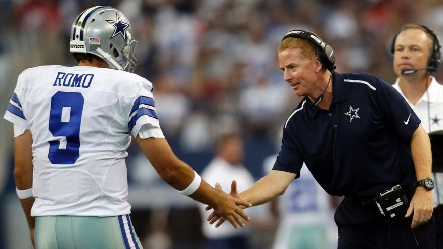<p>Dallas Cowboys' Tony Romo (9) shakes hands with head coach Jason Garrett after a touchdown against the San Francisco 49ers during the second half of an NFL football game, Sunday, Sept. 7, 2014, in Arlington, Texas. (AP Photo/Tony Gutierrez)</p>