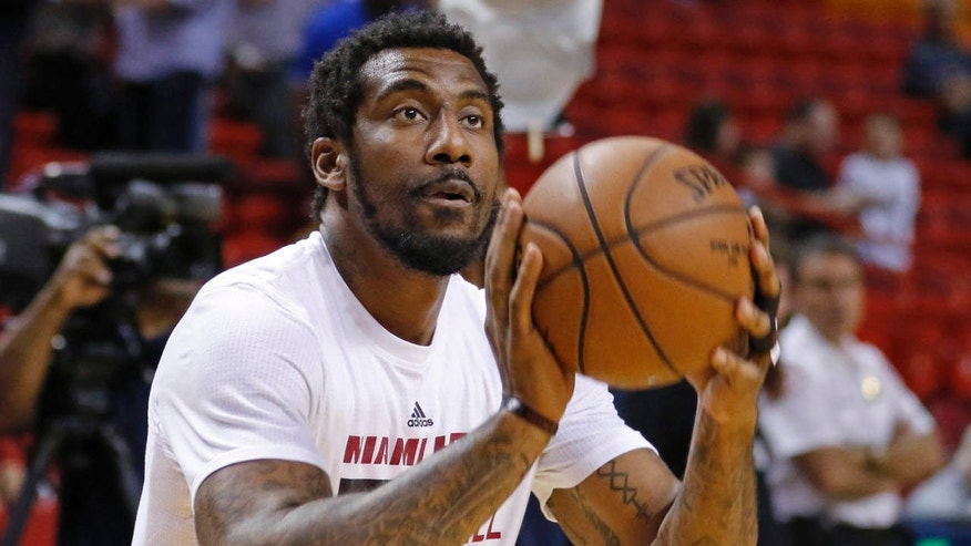 FILE - In this March 28, 2016, file photo, Miami Heat forward Amar'e Stoudemire shoots during warmups before the Heat met the Brooklyn Nets in an NBA basketball game, in Miami.