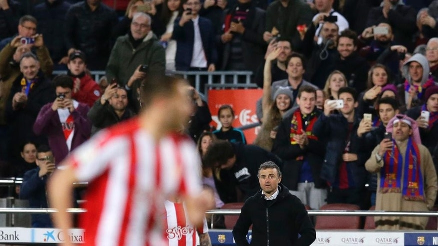 FC Barcelona's coach Luis Enrique, center right, stands during the Spanish La Liga soccer match between FC Barcelona and Sporting Gijon at the Camp Nou stadium in Barcelona, Spain, Wednesday, March 1, 2017. Luis Enrique says he will not stay as Barcelona coach after this season. The surprise announcement was made following the team's 6-1 win over Sporting Gijon in the Spanish league on Wednesday. (AP Photo/Manu Fernandez)