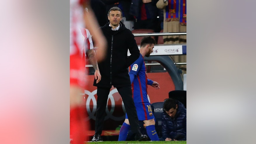 FC Barcelona's coach Luis Enrique, left, stands next Lionel Messi after been substituted during the Spanish La Liga soccer match between FC Barcelona and Sporting Gijon at the Camp Nou stadium in Barcelona, Spain, Wednesday, March 1, 2017. Luis Enrique says he will not stay as Barcelona coach after this season. The surprise announcement was made following the team's 6-1 win over Sporting Gijon in the Spanish league on Wednesday. (AP Photo/Manu Fernandez)