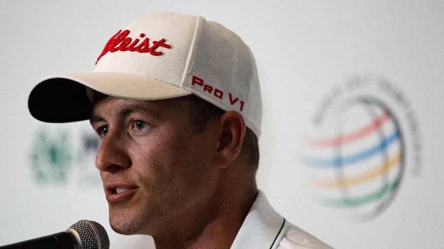 Defending champion Adam Scott, of Australia, answers questions during a press conference at Chapultepec Golf Club a day before the start of the Mexico Championship, in Mexico City, Wednesday, March 1, 2017. All but one of the world's top 50 golfers will contest the World Golf Championship PGA event, which this year relocated to Mexico City from the Trump National Doral Resort in Florida. (AP Photo/Rebecca Blackwell)
