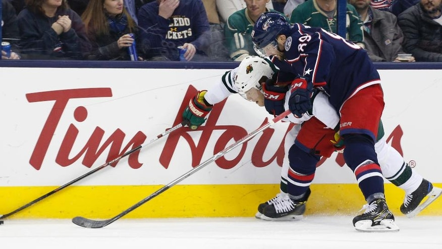 Minnesota Wild's Mikko Koivu, left, of Finland, and Columbus Blue Jackets' Sam Gagner vie for the puck during the third period of an NHL hockey game Thursday, March 2, 2017, in Columbus, Ohio. The Blue Jackets won 1-0. (AP Photo/Jay LaPrete)