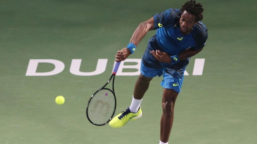 Gael Monfils of France serves the ball to Fernando Verdasco of Spain during a quarter final match of the Dubai Tennis Championships, in Dubai, United Arab Emirates, Thursday, March 2, 2017. (AP Photo/Kamran Jebreili)