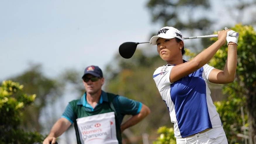 Lydia Ko of New Zealand tees off on the third hole during the HSBC Women's Champions golf tournament held at Sentosa Golf Club's Tanjong course on Thursday, March 2, 2017, in Singapore. (AP Photo/Wong Maye-E)