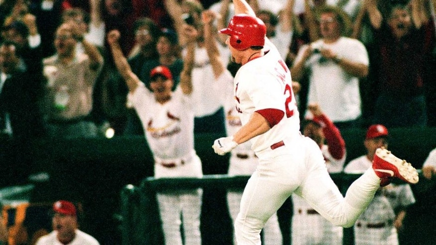 ST. LOUIS, MO - SEPTEMBER 8: Mark McGwire of the St. Louis Cardinals celebrates against the Chicago Cubs at Busch Stadium on September 8, 1998 in St. Louis, Missouri. (Photo by Sporting News via Getty Images)
