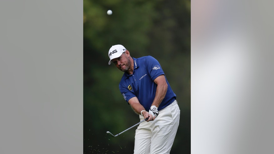 England's Lee Westwood chips the ball on the 9th hole in round one of the Mexico Championship at Chapultepec Golf Club in Mexico City, Thursday, March 2, 2017. All but one of the world's top 50 golfers are contesting the World Golf Championship PGA event, which this year relocated to Mexico City from the Trump National Doral Resort in Florida. (AP Photo/Rebecca Blackwell)