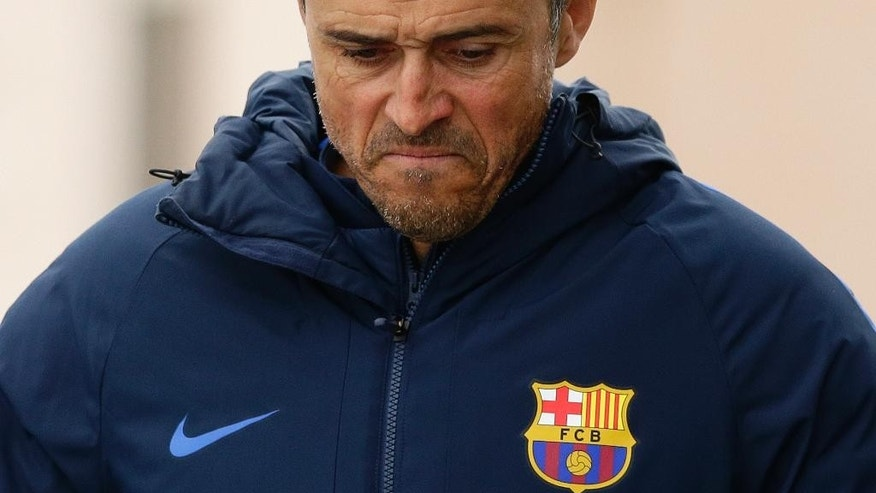 FC Barcelona's coach Luis Enrique arrives for a press conference at the Sports Center FC Barcelona Joan Gamper in Sant Joan Despi, Spain, Friday, March 3, 2017. Enrique will leave the Spanish champions at the end of this season. The coach made the surprise announcement following the team's 6-1 win over Sporting Gijon in the Spanish league on Wednesday March 1, 2017. (AP Photo/Manu Fernandez)