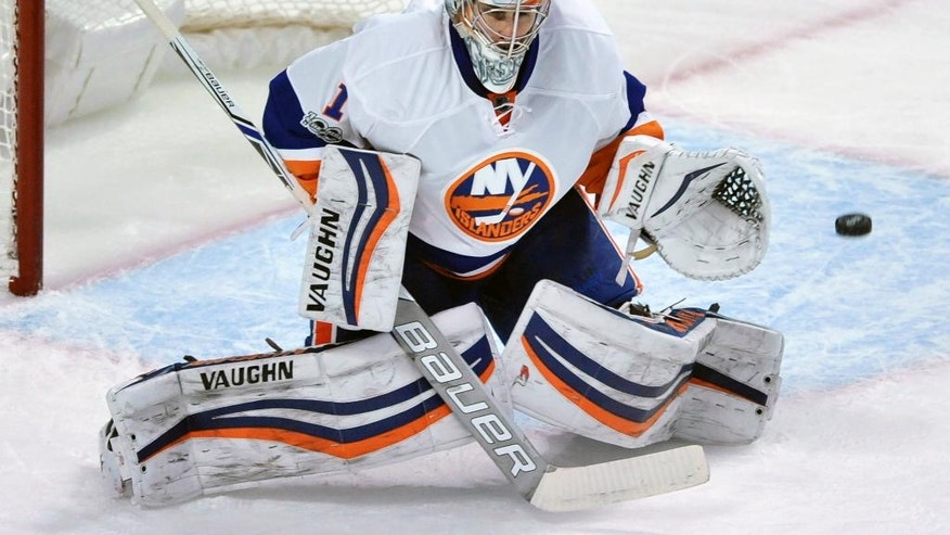 New York Islanders goalie Thomas Greiss, of Germany, makes a save during the first period of an NHL hockey game against the Chicago Blackhawks, Friday, March 3, 2017, in Chicago. (AP Photo/Paul Beaty)