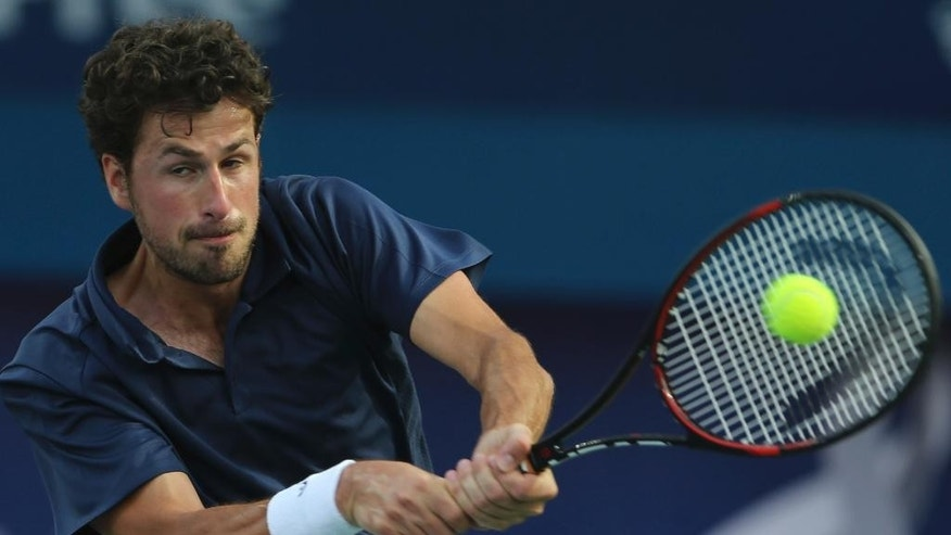 Robin Haase of Netherlands returns the ball to Fernando Verdasco of Spain during a semi final match of the Dubai Tennis Championships, in Dubai, United Arab Emirates, Friday, March 3, 2017. (AP Photo/Kamran Jebreili)