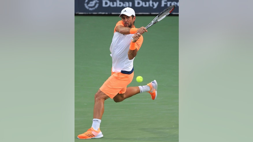Fernando Verdasco of Spain returns the ball to Robin Haase of Netherlands during a semi final match of the Dubai Tennis Championships, in Dubai, United Arab Emirates, Friday, March 3, 2017. (AP Photo/Kamran Jebreili)
