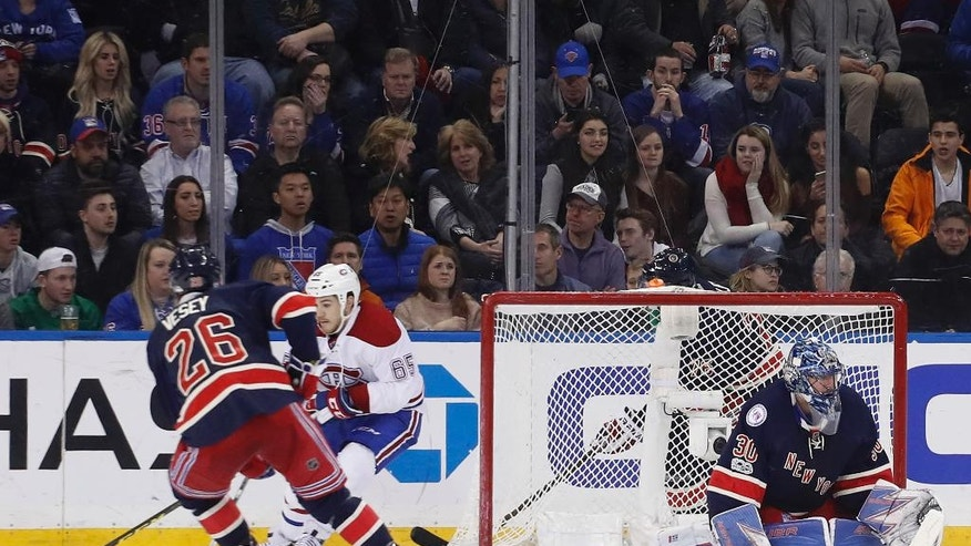 Montreal Canadiens center Andrew Shaw (65) wraps the puck around the goal against New York Rangers left wing Jimmy Vesey (26) to score on goalie Henrik Lundqvist (30) during the second period of an NHL hockey game, Saturday, March 4, 2017, in New York. (AP Photo/Julie Jacobson)