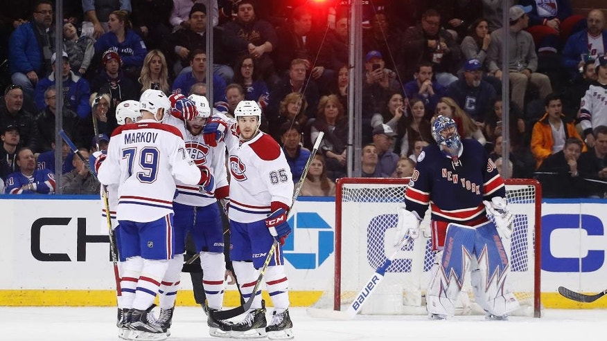 The Montreal Canadiens celebrate after a goal against New York Rangers goalie Henrik Lundqvist (30) during the second period of an NHL hockey game, Saturday, March 4, 2017, in New York. (AP Photo/Julie Jacobson)