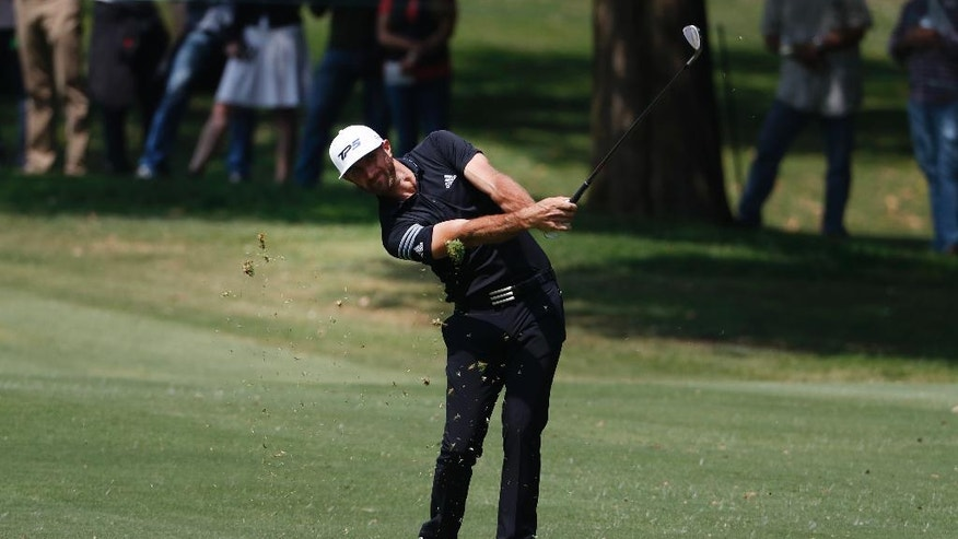 Dustin Johnson of the U.S. hits a ball on the 1st hole in round three of the Mexico Championship at Chapultepec Golf Club in Mexico City, Saturday, March 4, 2017. All but one of the world's top 50 golfers are contesting the World Golf Championship PGA event, which this year relocated to Mexico City from the Trump National Doral Resort in Florida. (AP Photo/Eduardo Verdugo)