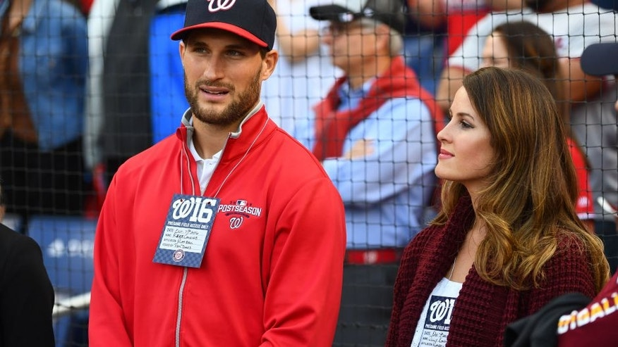 Oct 7, 2016; Washington, DC, USA; Washington Redskins quarterback Kirk Cousins (left) and wife Julie (right) look on before game one of the 2016 NLDS playoff baseball series between the Washington Nationals and the Los Angeles Dodgers at Nationals Park. Mandatory Credit: Brad Mills-USA TODAY Sports