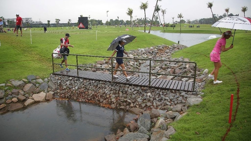 Lydia Ko of New Zealand walks across a bridge towards the putting green of the 7th hole during the HSBC Women's Champions golf tournament held at Sentosa Golf Club's Tanjong course on Saturday, March 4, 2017, in Singapore. (AP Photo/Wong Maye-E)