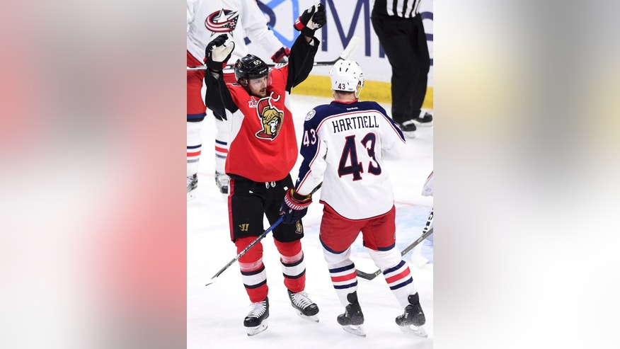 Ottawa Senators captain Erik Karlsson (65) celebrates a second-period goal in front of Columbus Blue Jackets left wing Scott Hartnell (43) during NHL hockey game action in Ottawa, Ontario, Saturday, March 4, 2017. (Sean Kilpatrick/The Canadian Press via AP)
