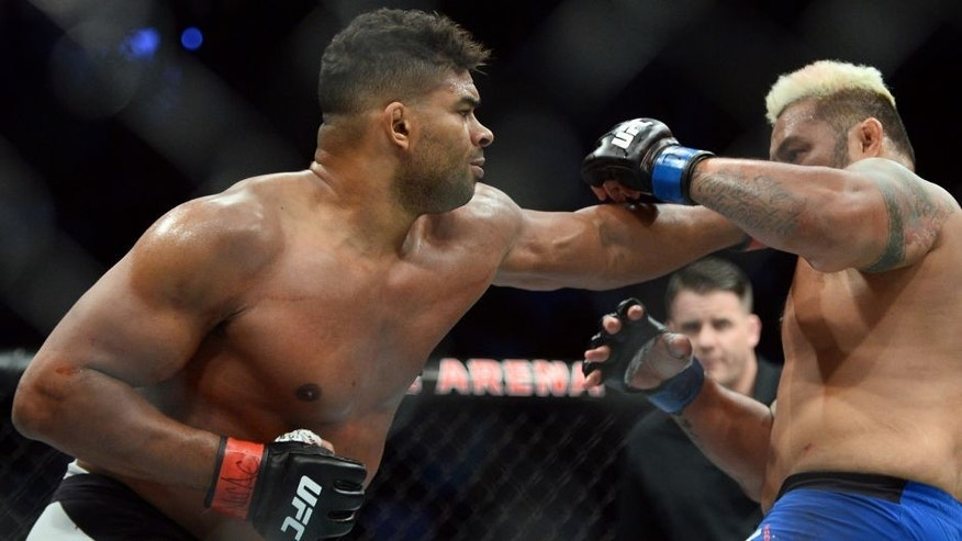 Mar 4, 2017; Las Vegas, NV, USA; Mark Hunt (blue gloves) and Alistair Overeem (red gloves) fight during their bout at UFC 209 at T-Mobile Arena. Overeem won via third round KO. Mandatory Credit: Joe Camporeale-USA TODAY Sports