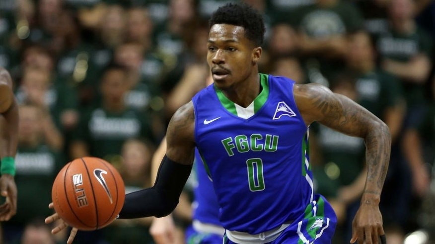 Nov 20, 2016; East Lansing, MI, USA; Florida Gulf Coast Eagles guard Brandon Goodwin (0) brings the ball up court against the Michigan State Spartans during the first half of a game at Jack Breslin Student Events Center. Mandatory Credit: Mike Carter-USA TODAY Sports