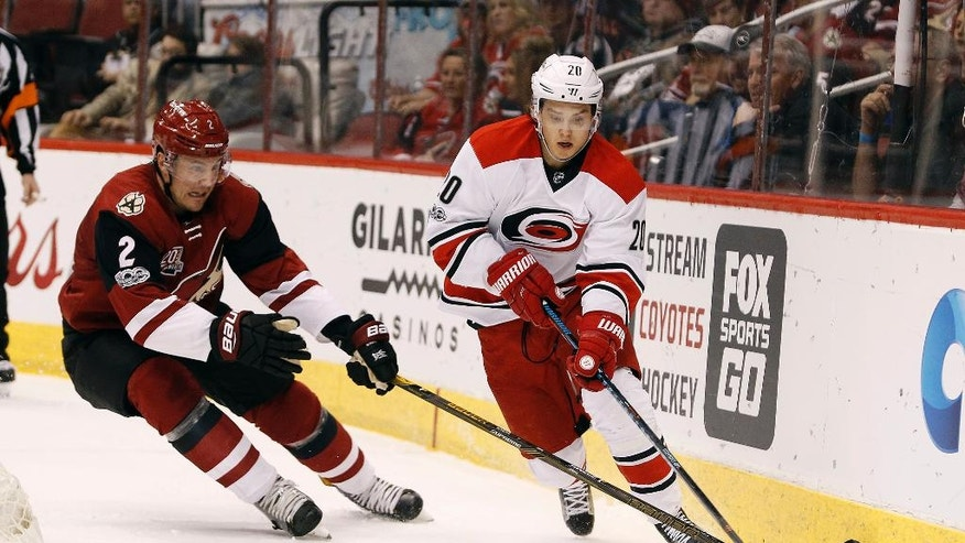 Carolina Hurricanes' Sebastian Aho (20) skates with the puck behind the net as Arizona Coyotes' Luke Schenn defends during the first period of an NHL hockey game, Sunday, March 5, 2017, in Glendale, Ariz. (AP Photo/Ralph Freso)