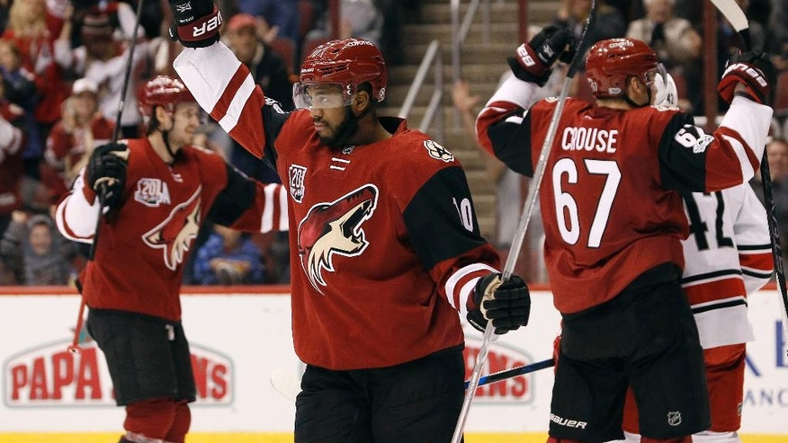 Arizona Coyotes winger Anthony Duclair (10) celebrates his assist on a goal by teammate Peter Holland during the second period of an NHL hockey game against the Carolina Hurricanes, Sunday, March 5, 2017, in Glendale, Ariz. (AP Photo/Ralph Freso)