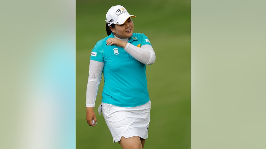 Inbee Park of South Korea celebrates after winning the HSBC Women's Champions golf tournament held at Sentosa Golf Club's Tanjong course on Sunday, March 5, 2017, in Singapore. (AP Photo/Wong Maye-E)