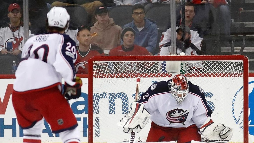 Columbus Blue Jackets goalie Sergei Bobrovsky, of Russia, blocks a shot by the New Jersey Devils during the first period of an NHL hockey game, Sunday, March 5, 2017, in Newark, N.J. (AP Photo/Julio Cortez)